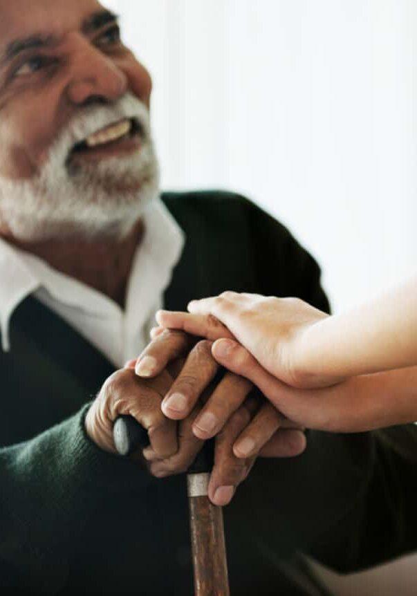 Elderly Man Being Supported