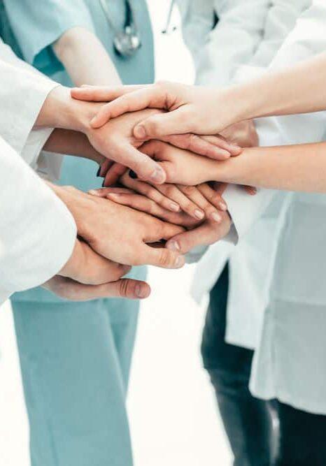doctors hands together