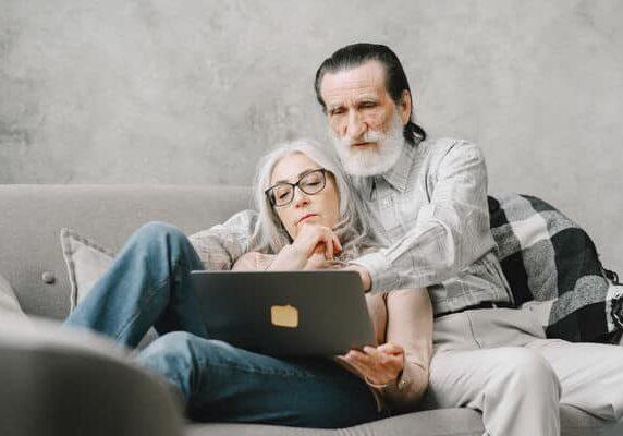 Seniors Looking at Laptop