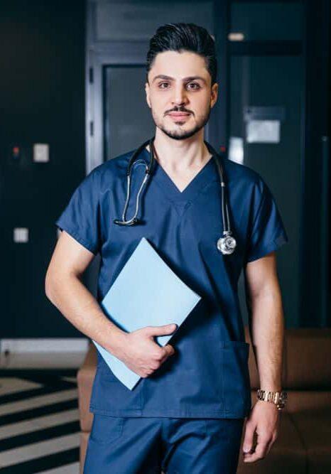 Doctor standing in room